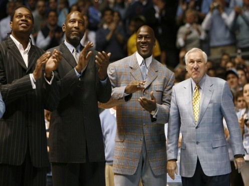 Former University of North Carolina players Sam Perkins, James Worthy and Michael Jordan, along with former North Carolina head basketball coach Dean Smith, watch a presentation honoring the 1957 and 1982 national championship teams on Feb. 10, 2007. (Ellen Ozier/Reuters)