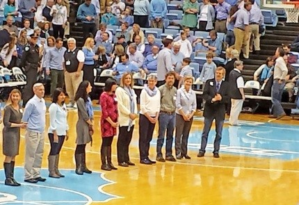 Winners of UNC teaching excellence awards were honored on the court at halftime of the Florida State University game on Jan. 24. Dr. Karl Umble (second from left) and Dr. Susan Ennett (fourth from right) are awardees from the Gillings School. Photo by Jo Anne Earp.