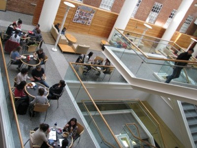 The Armfield Atrium, in the center of the Gillings School, features plenty of natural light, stairs and tables for meeting over a meal or snack from the cafe.
