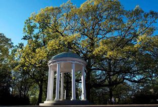 UNC-Chapel Hill's iconic Old Well stands proud under a Carolina blue sky on University Day 2016.