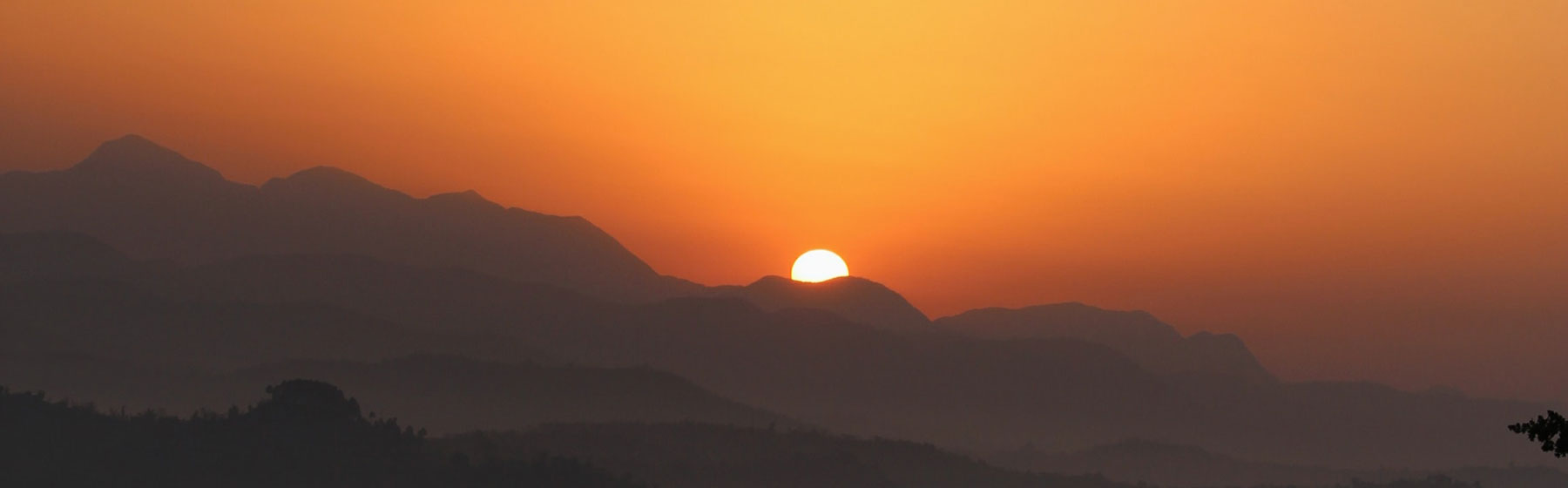 The sun rises over the mountains..