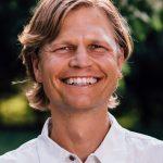 Photo of Dr. Travis Johnson, big smile