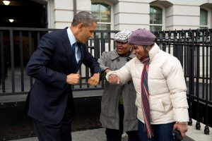 Barack Obama greets GSA staffers with elbow bumps.